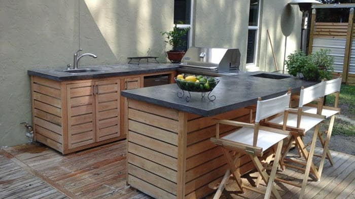 outdoor kitchen with concrete countertops