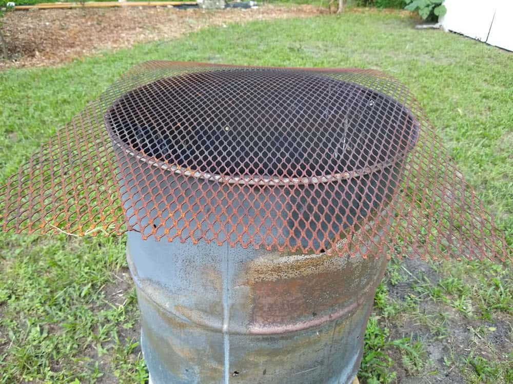 grate cover on top of burn barrel to keep sparks from flying