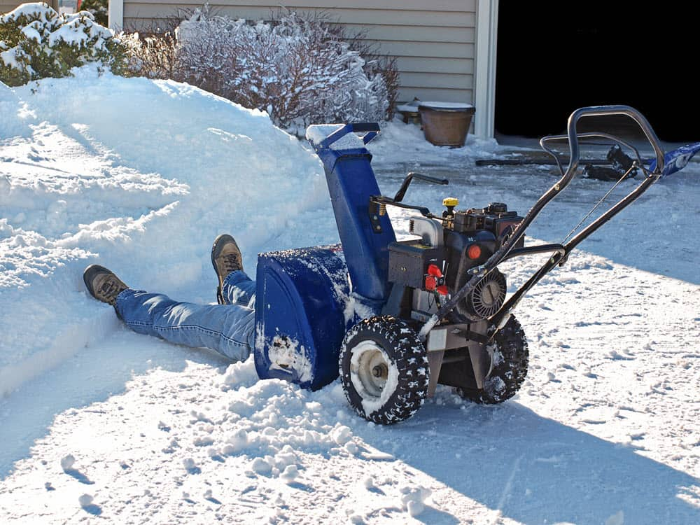 man working on a snowblower