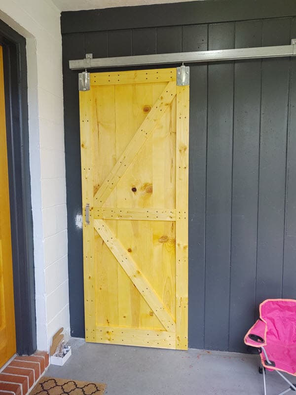 finished installation of board and batten bard door