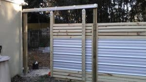 horizontal fence with metal accents gate
